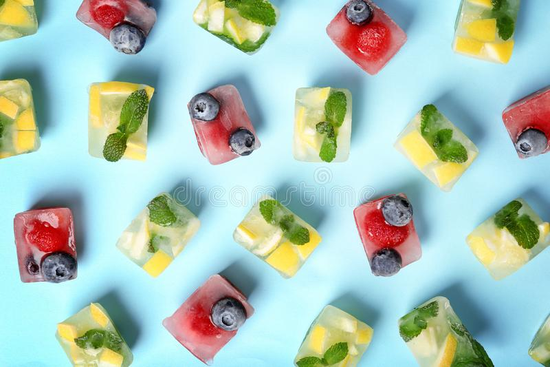 Flat lay composition with fruit and berry ice cubes royalty free stock photo