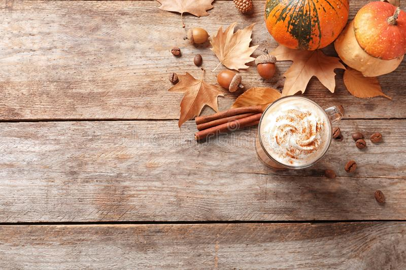Flat lay composition with glass cup of tasty pumpkin spice latte and space for text royalty free stock images