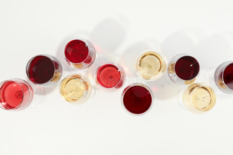 Flat lay composition. Glasses with different wine on white background royalty free stock image
