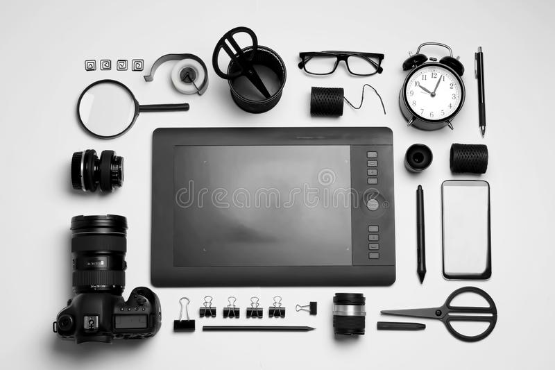 Flat lay composition with graphic drawing tablet and office items on white background. Designer`s workplace. Flat lay composition with graphic drawing tablet and stock photography