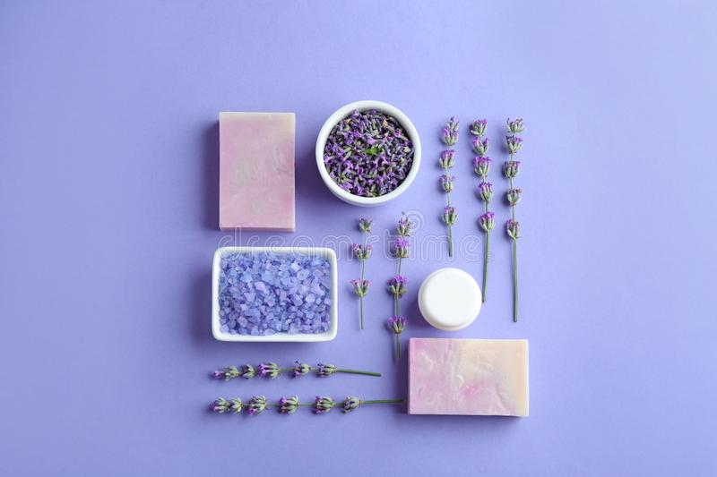 Flat lay composition with hand made soap bars and lavender flowers on background. Flat lay composition with hand made soap bars and lavender flowers on violet royalty free stock image