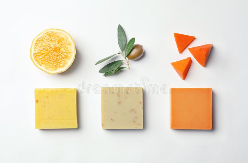 Flat lay composition with handmade soap bars and ingredients royalty free stock photos