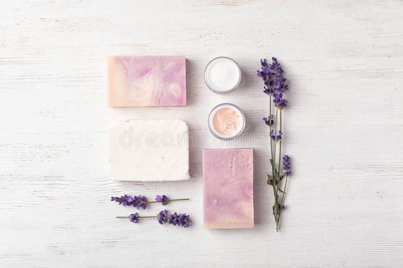 Flat lay composition with handmade soap bars and ingredients royalty free stock images