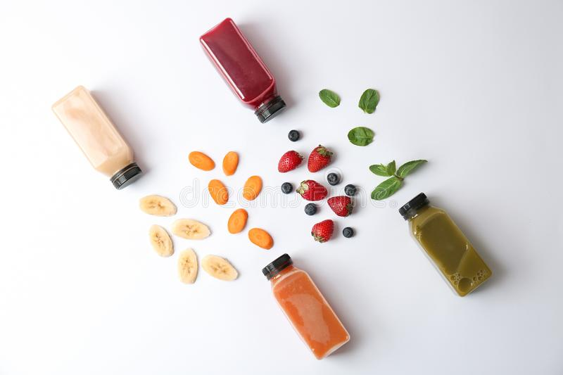 Flat lay composition with healthy detox smoothies. And ingredients on light background stock image
