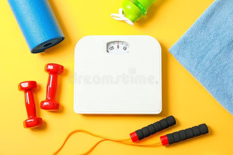 Flat lay composition with healthy lifestyle accessories. On color background stock photos