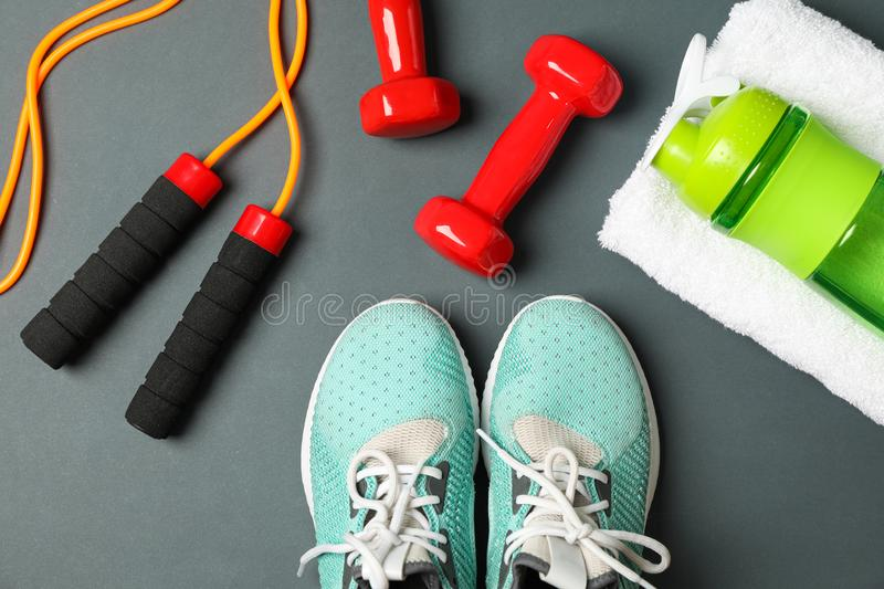 Flat lay composition with healthy lifestyle accessories. On dark background royalty free stock photo