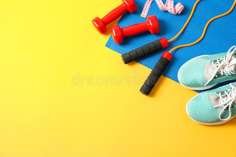 Flat lay composition with healthy lifestyle accessories. On color background stock photography