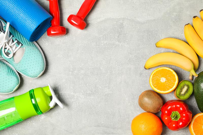Flat lay composition with healthy lifestyle accessories. On grey background stock photography