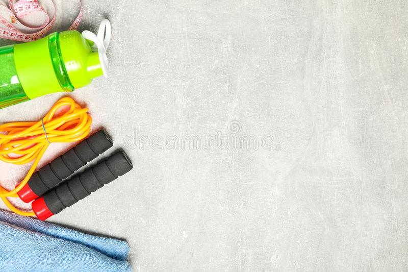 Flat lay composition with healthy lifestyle accessories. On grey background royalty free stock photos