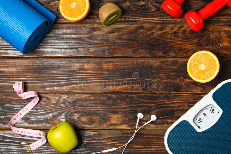 Flat lay composition with healthy lifestyle accessories. On wooden background royalty free stock images