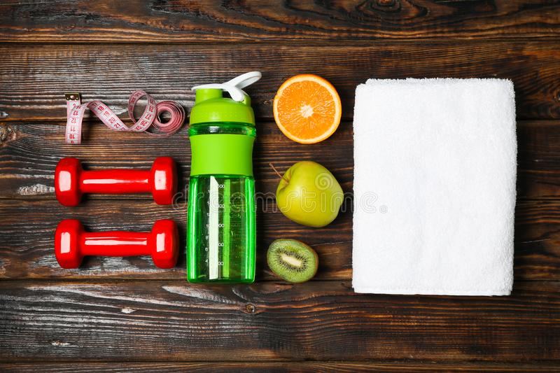 Flat lay composition with healthy lifestyle accessories. On wooden background stock photography