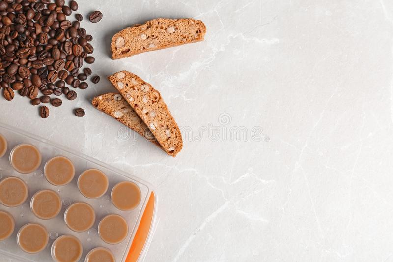 Flat lay composition with ice cube tray, coffee beans on light background stock photos