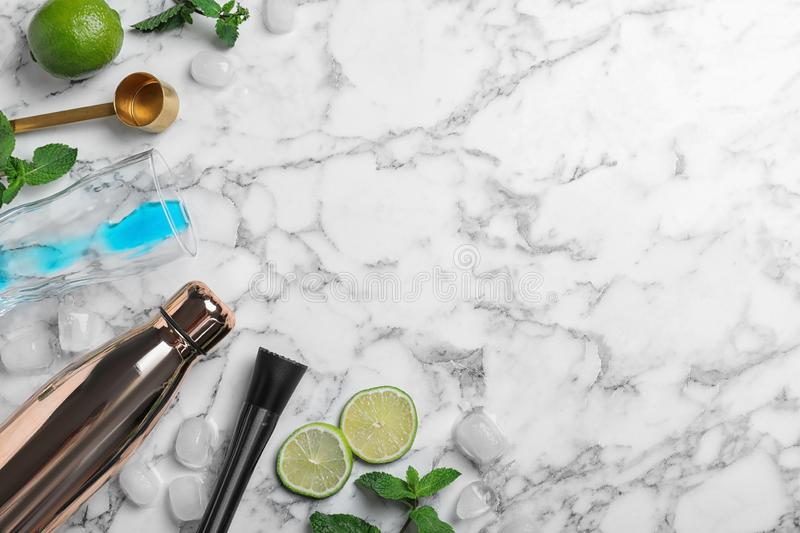 Flat lay composition with  for cocktail and bar equipment on white marble background. Space for text. Flat lay composition with ingredients for cocktail and bar royalty free stock images