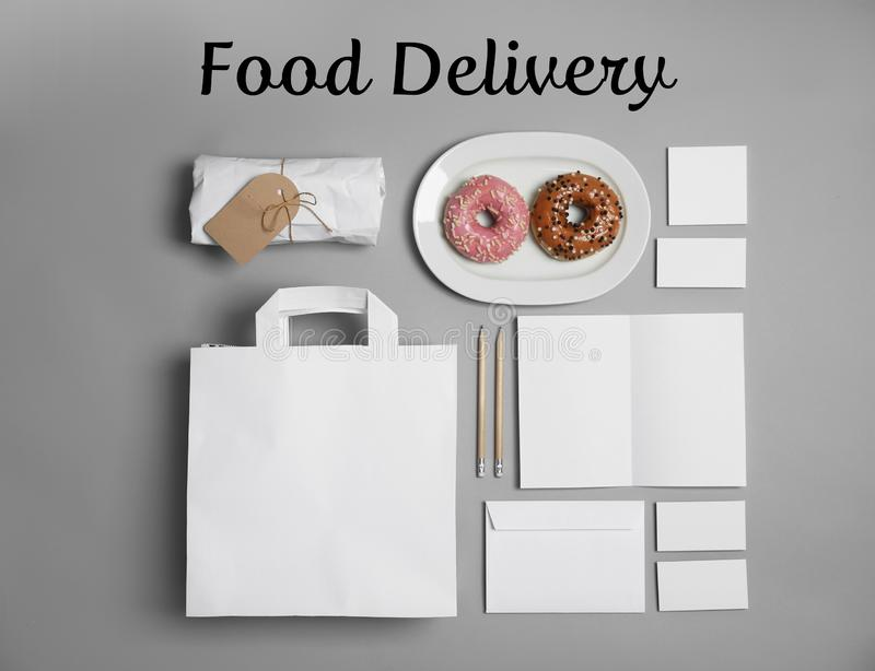 Flat lay composition with items for mock up design on gray background. Food delivery service royalty free stock photos