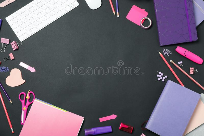 Flat lay composition with keyboard and stationery on background, space for text. Designer`s workplace. Flat lay composition with keyboard and stationery on black stock image