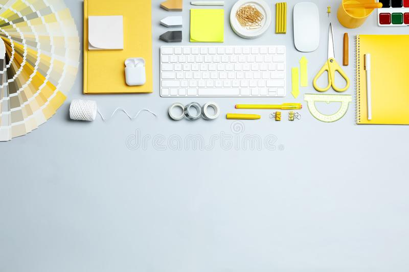 Flat lay composition with keyboard and stationery on  background, space for text. Designer`s workplace. Flat lay composition with keyboard and stationery on royalty free stock photos