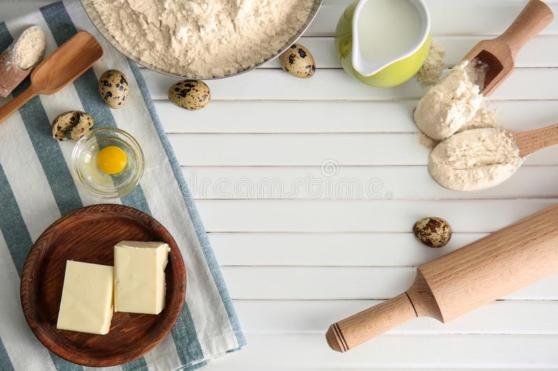 Flat lay composition with kitchen utensils and products on wooden background. Bakery workshop royalty free stock images