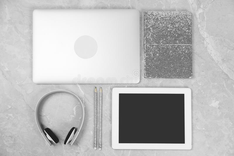 Flat lay composition with laptop, tablet and notebook on marble table, space for text. Designer`s workplace royalty free stock image