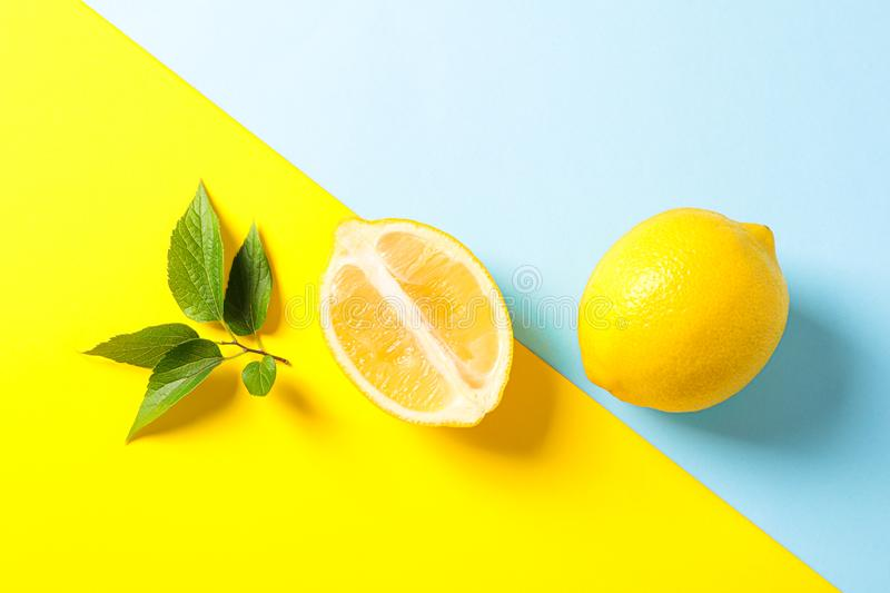 Flat lay composition with lemons on two tone background. Space for text stock photo
