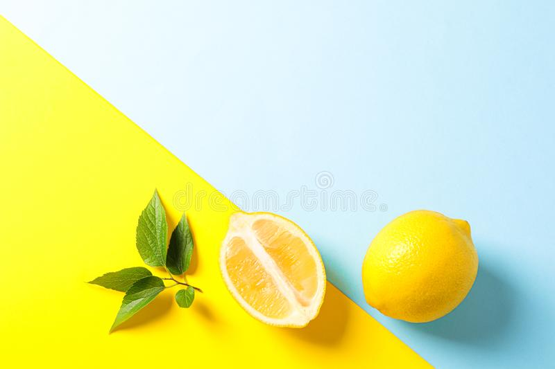 Flat lay composition with lemons on two tone background. Space for text stock photography