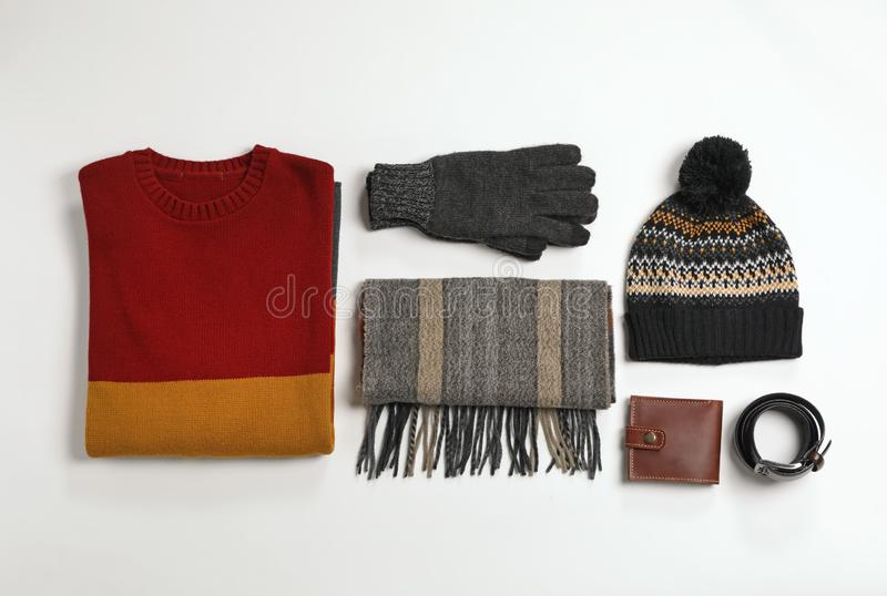 Flat lay composition with male winter clothes. On white background stock images