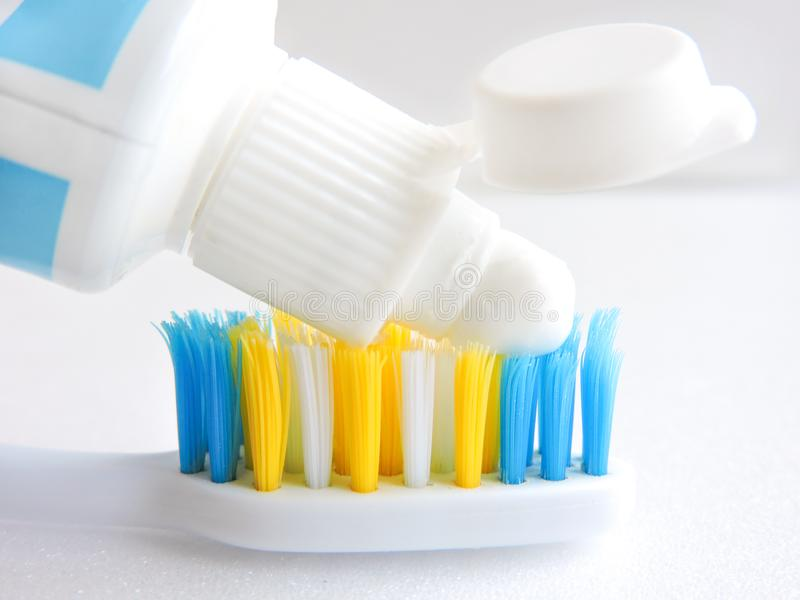 Flat lay composition with manual toothbrushes on white background.Toothbrush and toothpaste.op view, flat lay. Minimal concept, space for text.set of stock photography