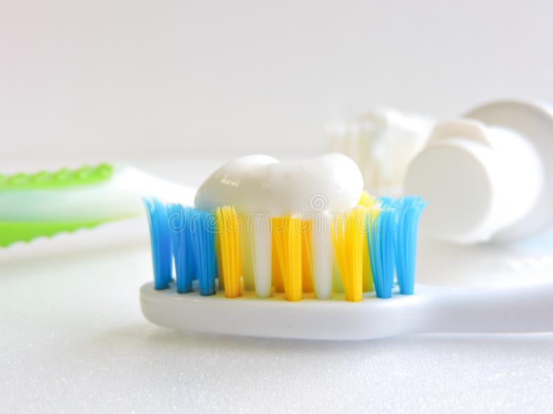 Flat lay composition with manual toothbrushes on white background.Toothbrush and toothpaste.op view, flat lay. Minimal concept, space for text.set of stock image