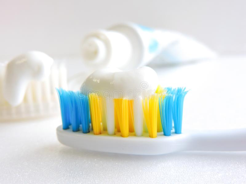 Flat lay composition with manual toothbrushes on white background.Toothbrush and toothpaste.op view, flat lay. Minimal concept, space for text.set of royalty free stock image
