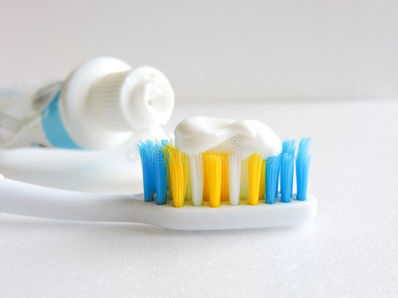 Flat lay composition with manual toothbrushes on white background.Toothbrush and toothpaste.op view, flat lay. Minimal concept, space for text.set of royalty free stock images