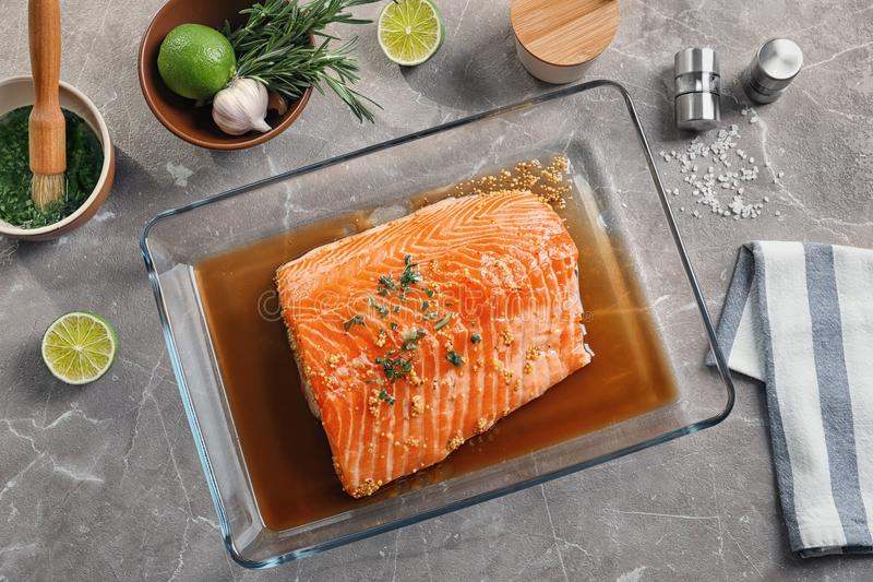 Flat lay composition with marinated salmon fillet. And ingredients on table stock images