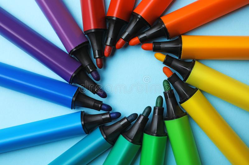 Flat lay composition with markers on color background. Rainbow palette royalty free stock photo