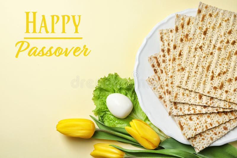 Flat lay composition with matzo and space for text on color background. Passover Pesach. Seder royalty free stock photo