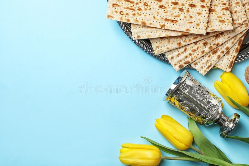 Flat lay composition with matzo and space for text on color background. Passover Pesach Seder stock image