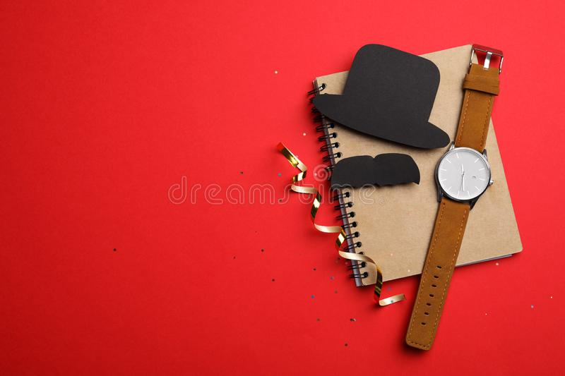 Flat lay composition with men`s accessories on red background. Greeting card. Flat lay composition with men`s accessories on red background, space for text royalty free stock images