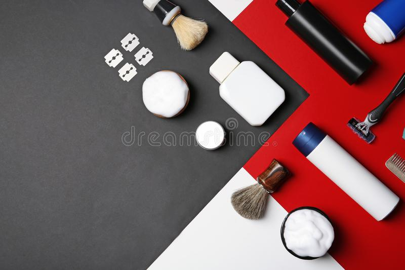 Flat lay composition with men`s shaving accessories and space for text. On color background stock photos