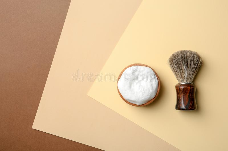 Flat lay composition with men`s shaving accessories and space for text. On color background stock photo