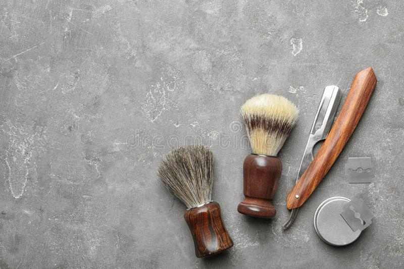 Flat lay composition with men`s shaving accessories and space for text. On gray background stock photo