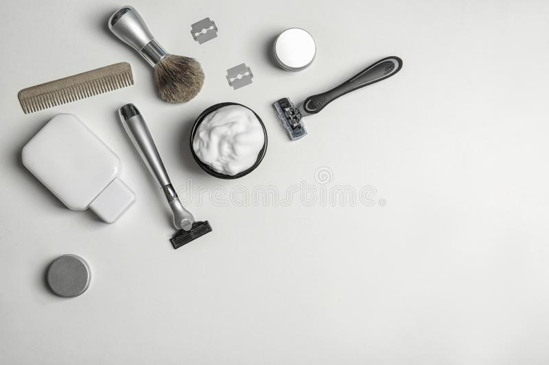 Flat lay composition with men`s shaving accessories and space for text. On white background stock photos