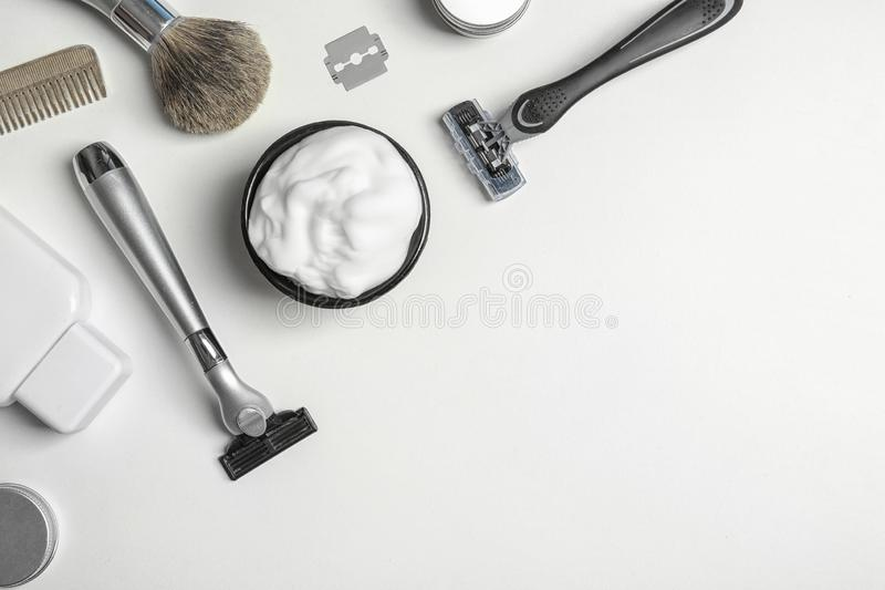 Flat lay composition with men`s shaving accessories and space for text. On white background royalty free stock images