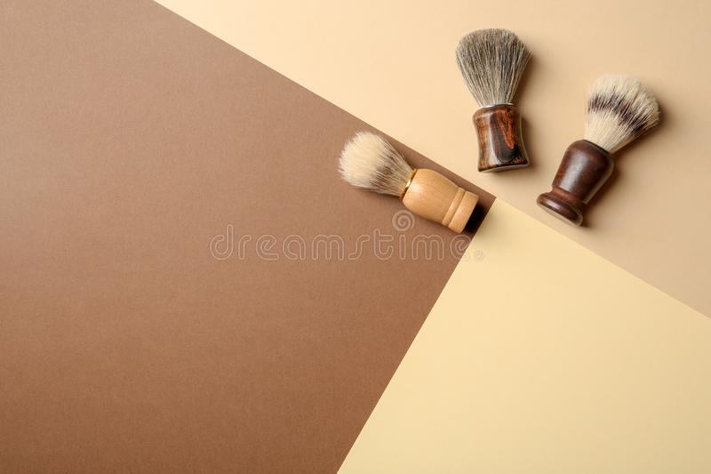 Flat lay composition with men`s shaving brushes. And space for text on color background royalty free stock images