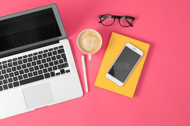 Flat lay composition with modern devices and office tools on background. Flat lay composition with modern devices and office tools on pink background stock photography