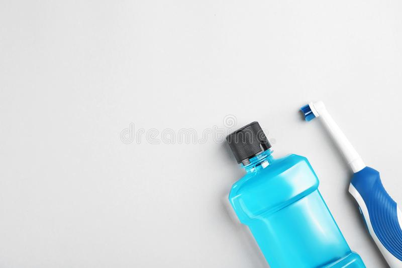 Flat lay composition with mouthwash, toothbrush. And space for text on light background. Teeth hygiene stock image