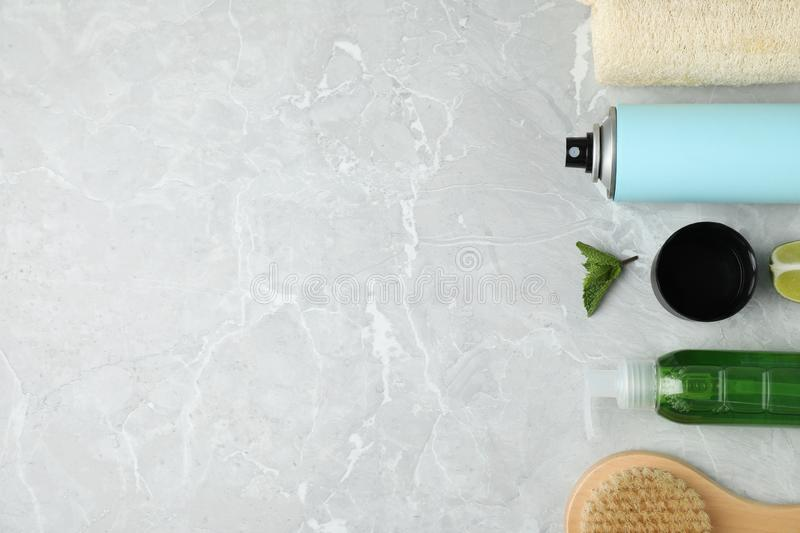 Flat lay composition with natural deodorant and bath accessories on light grey marble table. Space for text royalty free stock images