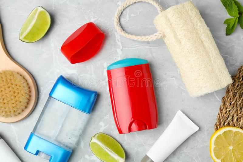 Flat lay composition with natural deodorants and bath accessories. On light grey marble table royalty free stock images