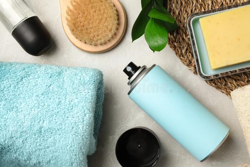 Flat lay composition with  deodorants and bath accessories on light grey marble table. Flat lay composition with natural deodorants and bath accessories on light royalty free stock photo