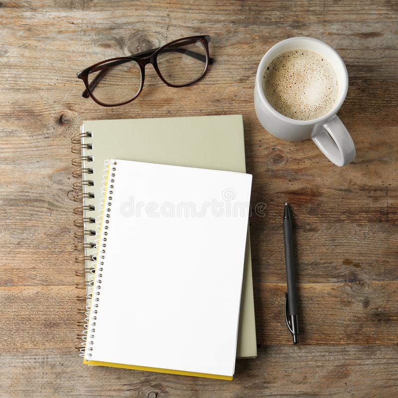 Flat lay composition with office stationery and cup of coffee. Space for design. Flat lay composition with office stationery and cup of coffee on wooden table royalty free stock image