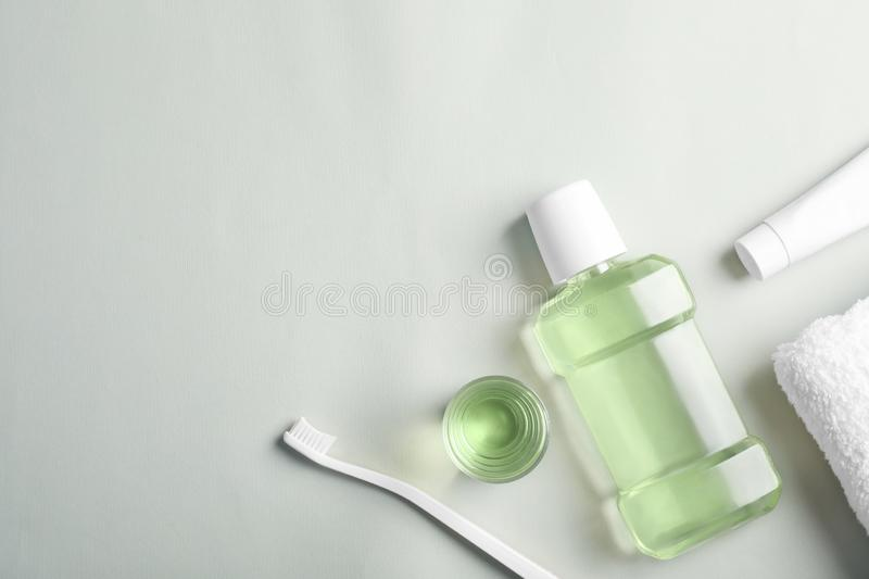 Flat lay composition with oral care products and space for text on light background. Teeth hygiene stock image