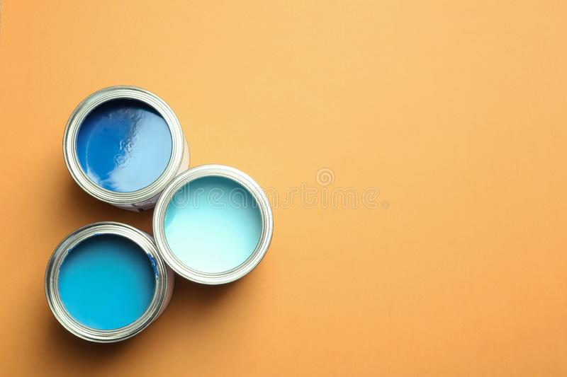 Flat lay composition with paint cans and space for tex royalty free stock image