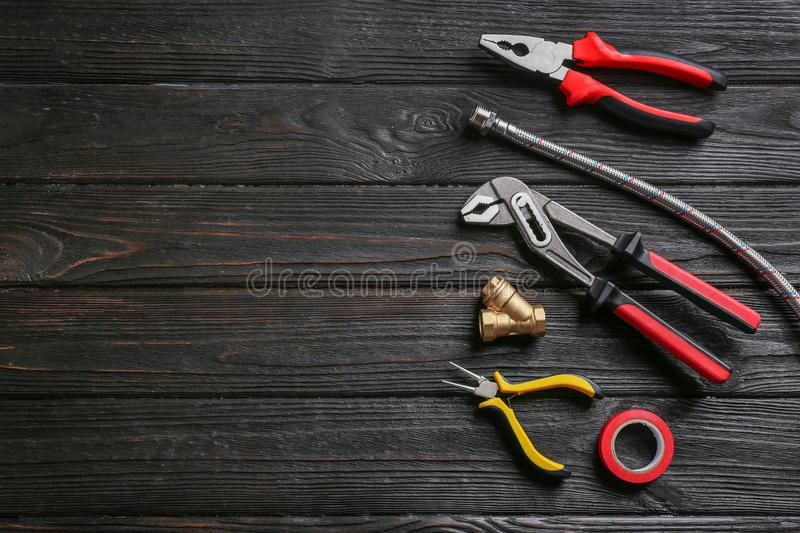 Flat lay composition with plumber`s tools and space for text stock photography