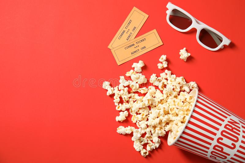 Flat lay composition with popcorn and space for text on color background. royalty free stock image